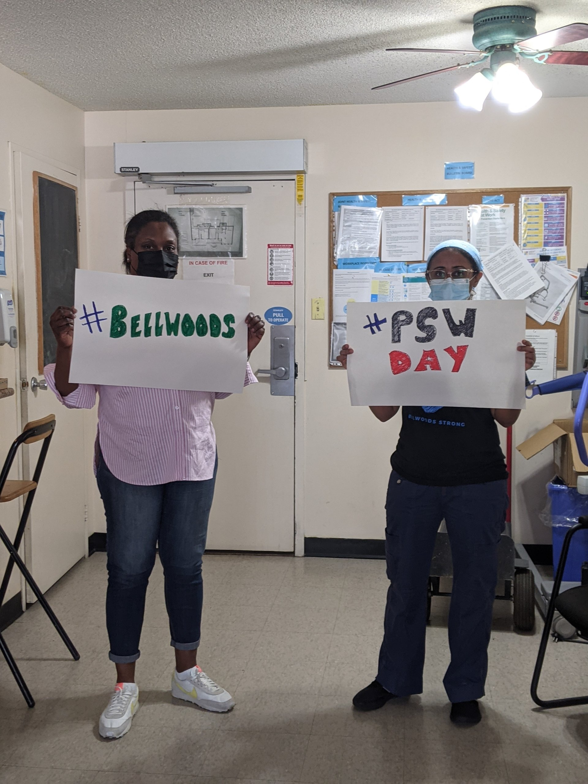 Bellwoods staff holds up signs #Bellwoods and #PSW Day